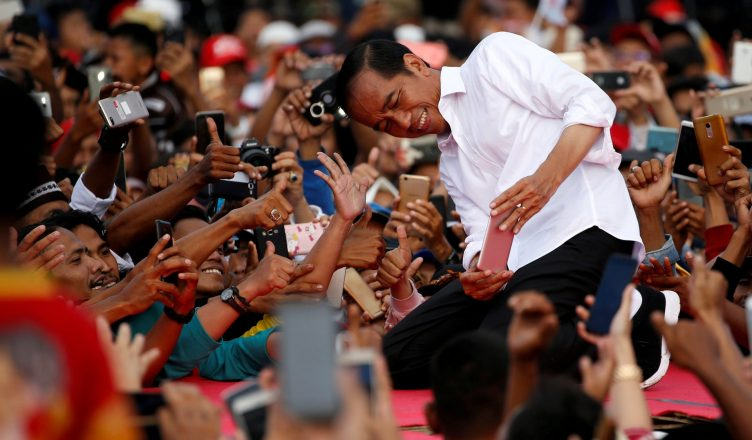 Joko Widodo takes pictures with his supporters during his first campaign rally at a stadium in Serang, Banten province in Indonesia. Photograph: Willy Kurniawan/Reuters